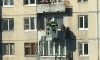 Очевидцы сняли спасение пенсионерки с балкона на Искровском на фото
